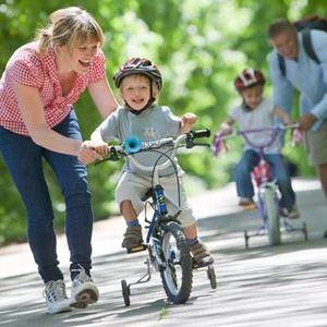 Научить ездить на двухколесном велосипеде